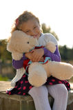 Girl. The little curly-haired girl holding a teddy bear Stock Image