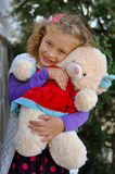 Girl. The little curly-haired girl holding a teddy bear Stock Photography