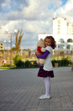 Girl. The little curly-haired girl holding a teddy bear Stock Images