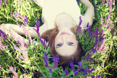 Girl liyng on spring grass. Girl liyng on spring grass and flowers Royalty Free Stock Image