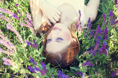 Girl liyng on spring grass   Stock Photo