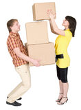 Girl loads the man with cardboard boxes Royalty Free Stock Images