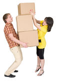 Girl Loads The Man With Cardboard Boxes Stock Images