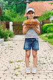 Girl with loaf of bread Stock Photography