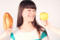 Girl with loaf of bread and apple Stock Image