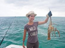 Girl with a lobster. Cuba Royalty Free Stock Photo