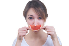 Girl with lobule of grapefruit Royalty Free Stock Photos