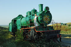 A girl and a locomotive. Stock Image