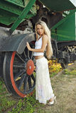 A girl and a locomotive. Stock Images