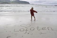 Girl on lofoten beach royalty free stock images