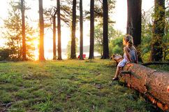 Girl on a Log. Girl in nature sitting on a log Royalty Free Stock Photography