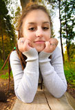 Girl on log Royalty Free Stock Images