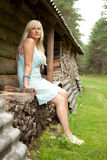Girl on the log pile Stock Photos