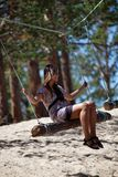 Girl on a Log Rope Swing Royalty Free Stock Photography