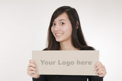 Girl with logo sign left Stock Image