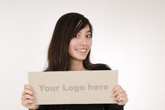 Girl with logo sign right Stock Photo