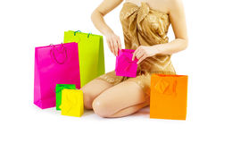 A girl loking in paper  bags Stock Photography
