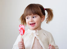 Girl and a lollipop Royalty Free Stock Image