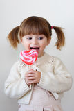 Girl and a lollipop Royalty Free Stock Images