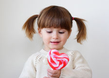 Girl and a lollipop Stock Photography