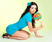 Girl with a lollipop Stock Images