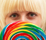 Girl with lollipop. A young attractive girl with a colorful lollipop Stock Image