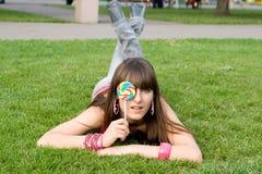 Girl with a lollipop Stock Photos