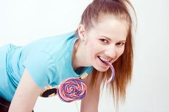 Girl with a lollipop Stock Photos