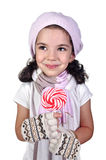 Girl and lollipop. Girl with a lollipop in her hands Royalty Free Stock Photography