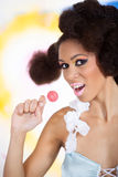 Girl with lollipop Royalty Free Stock Images
