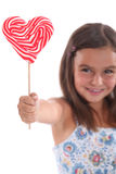 Girl with lollipop Royalty Free Stock Photography
