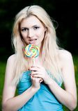 Girl And Lollipop Royalty Free Stock Photos