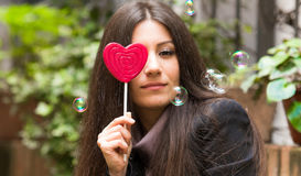 Girl with lollipop Stock Photography