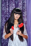 Girl and lollipop broken heart Stock Photos
