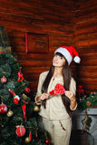 Girl with lollipop and Christmas tree Royalty Free Stock Image