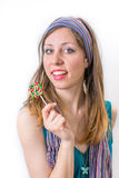 Girl with a lollipop Stock Photography