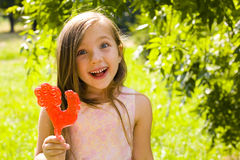Girl and a lollipop. Funny emotional girl with a lollipop in his hand Royalty Free Stock Image