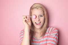 Girl with lollipop on her bedroom Stock Image