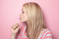 Girl with lollipop on her bedroom Stock Photos