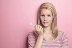 Girl with lollipop on her bedroom Royalty Free Stock Photos