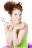 Girl with a lollipop in his hand Stock Photography