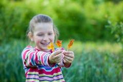 Girl and a lollipop Stock Photos