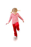 Girl with lollipop jumping Royalty Free Stock Photography