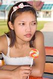Girl with lollipop. Portrait of girl with lollipop Royalty Free Stock Photos