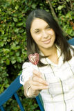 Girl with a lollipop in the shape of a heart Stock Photo