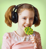 Girl and a lollipop Stock Images