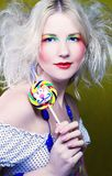Girl with lollipop Stock Photos