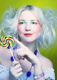 Girl with lollipop Stock Photos