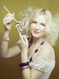 Girl with lollipop Stock Images