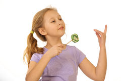 Girl with lollipop on a white background royalty free stock image